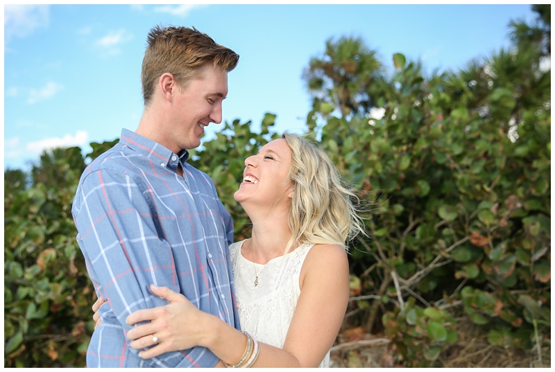 Laughing Engagement Photo at Beach