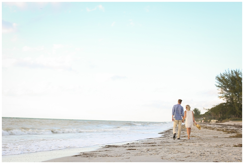 Engagement session walk on beach