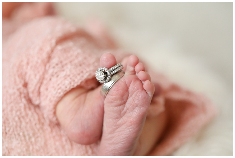 Newborn wedding rings on toes