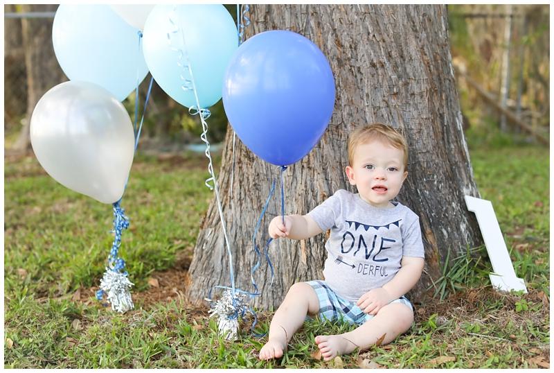 Blue balloons boy first birthday