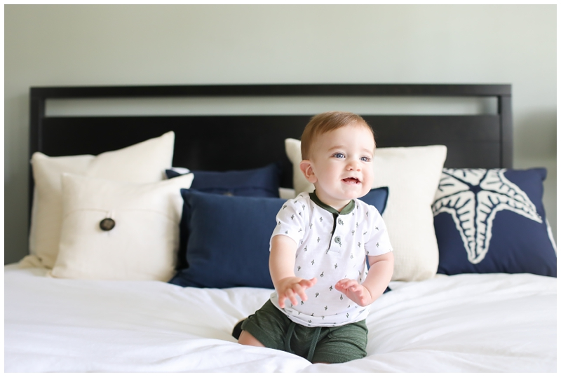 Baby crawling on bed photo