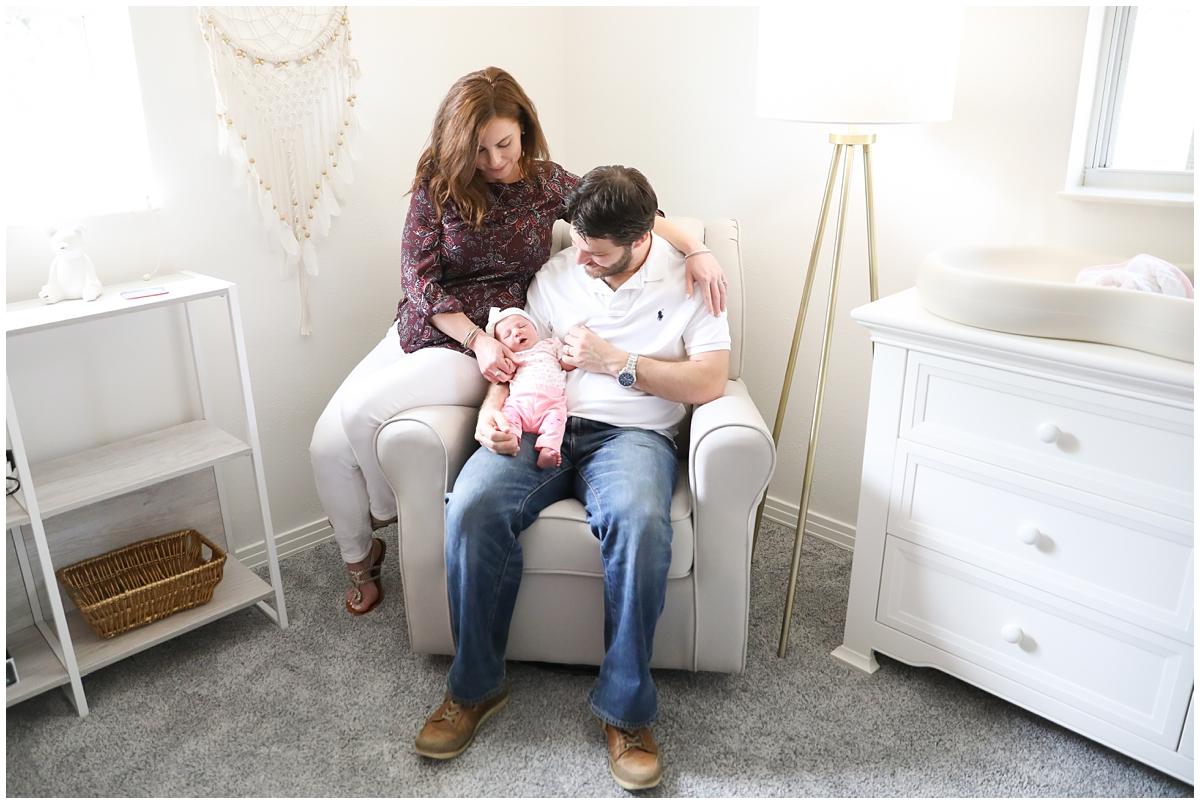 Family in rocker in nursery