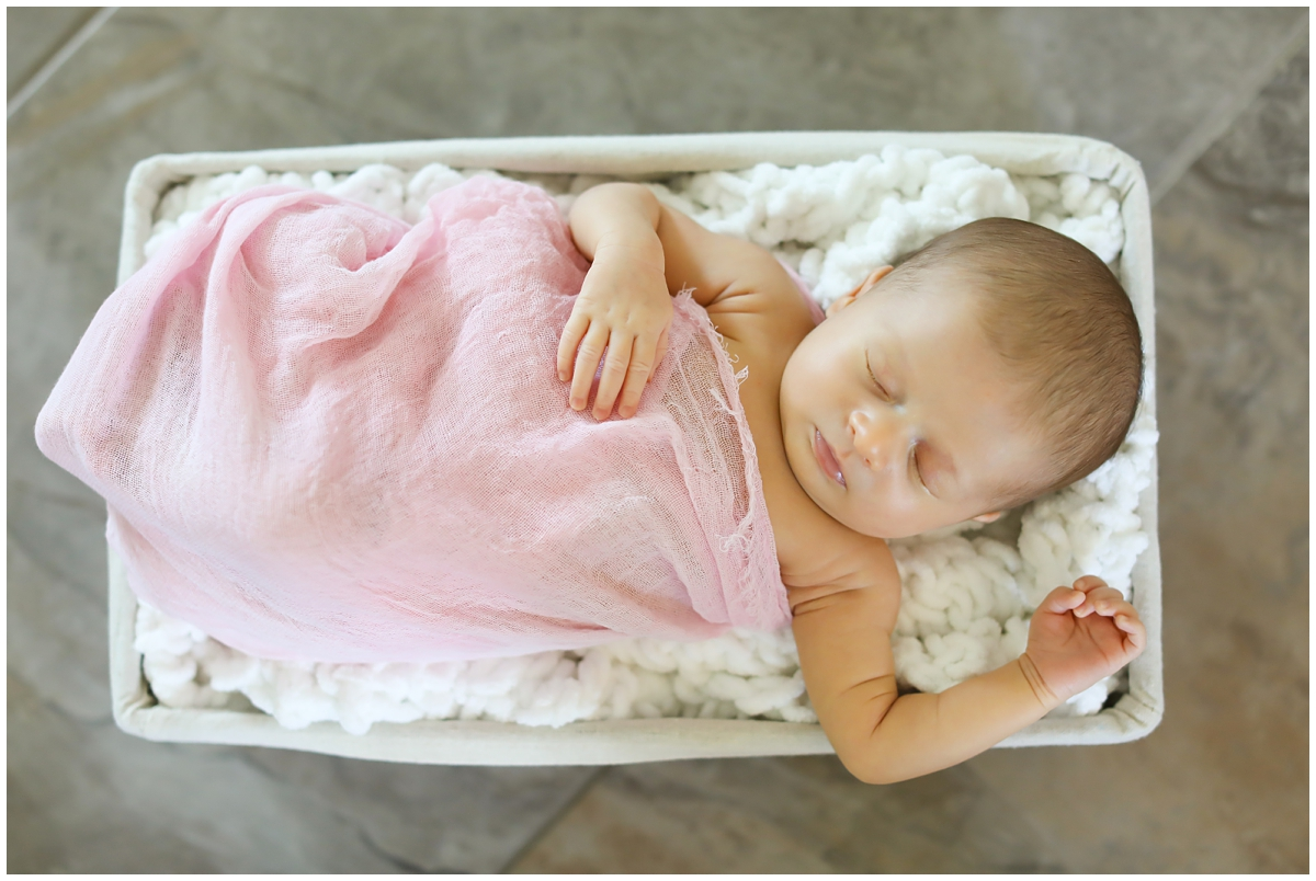 Baby girl newborn session pink swaddle