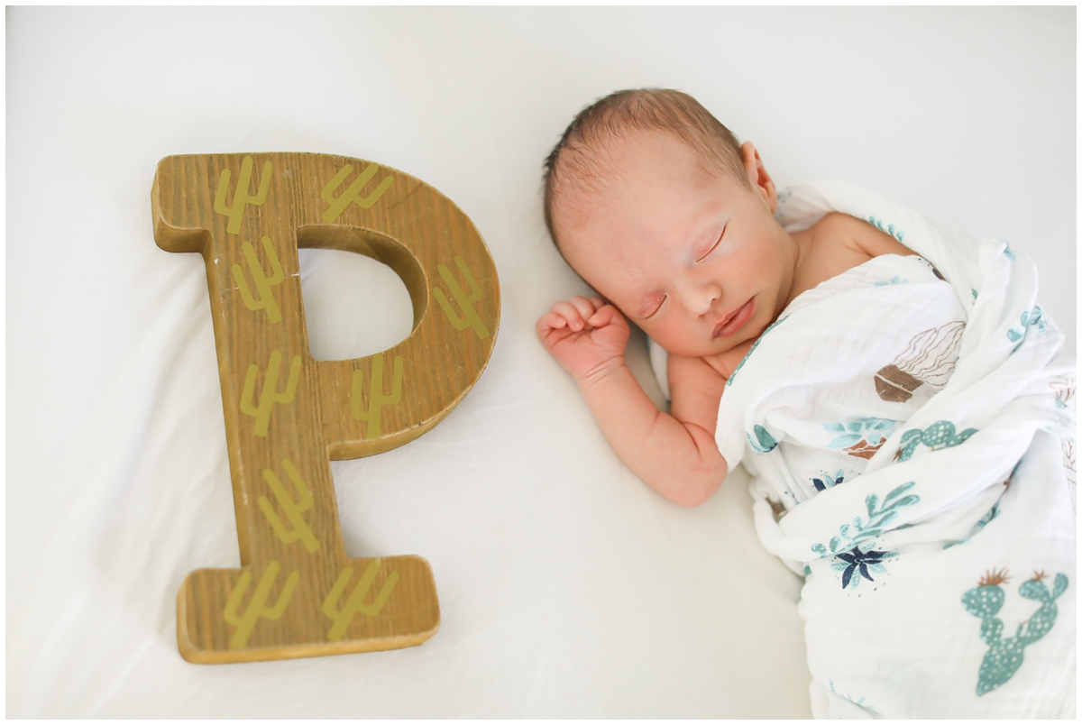 Baby with letter of name